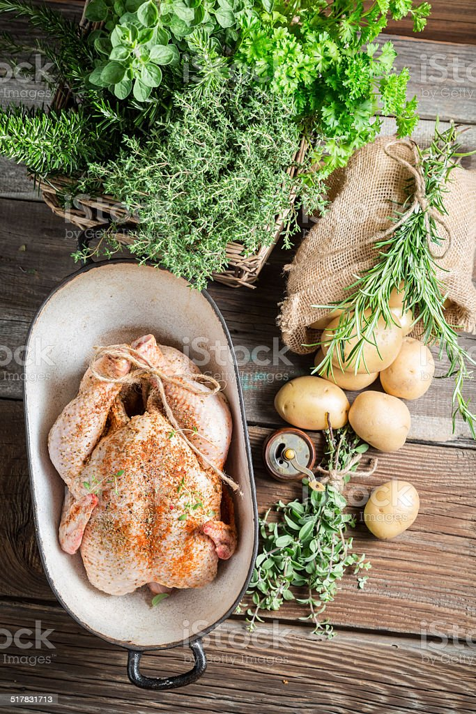 Chicken for cooking with spices and vegetables stock photo