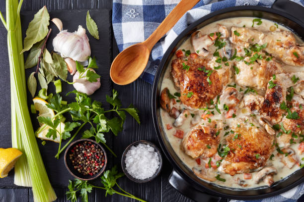 chicken fricassee in a black dutch oven - braised stock pictures, royalty-free photos & images