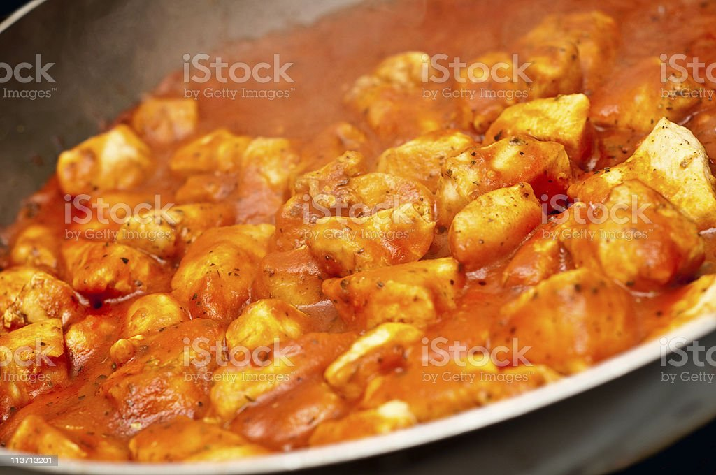 chicken fried in tomato sauce royalty-free stock photo