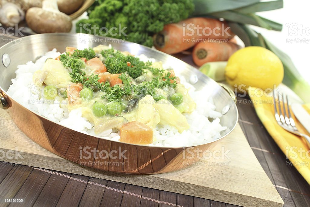chicken frikassee with rice and carrots stock photo