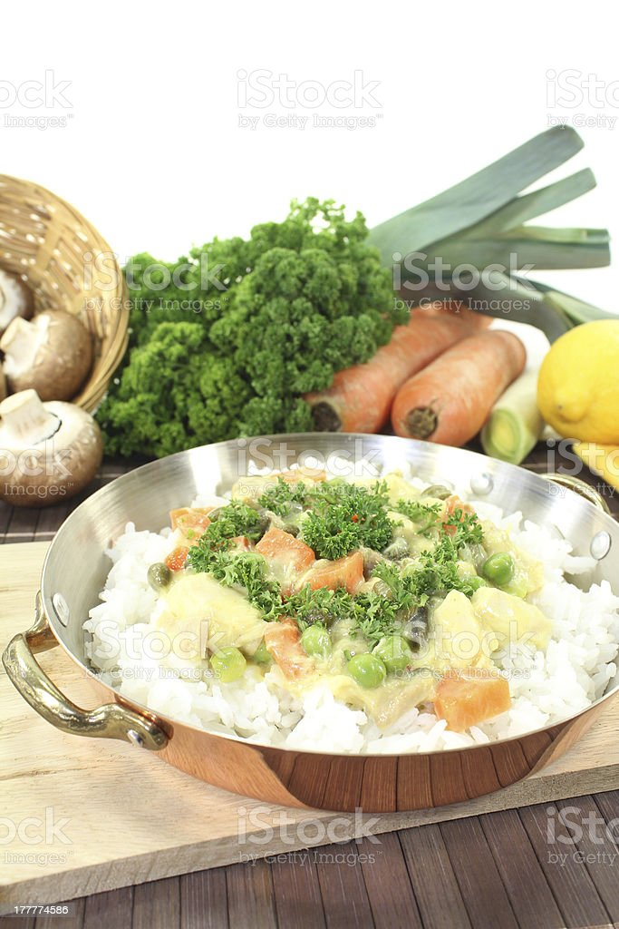 chicken frikassee with rice and peas stock photo