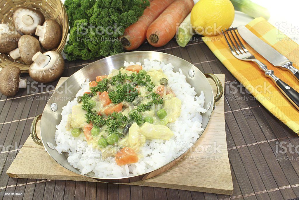 chicken frikassee with rice and vegetables stock photo