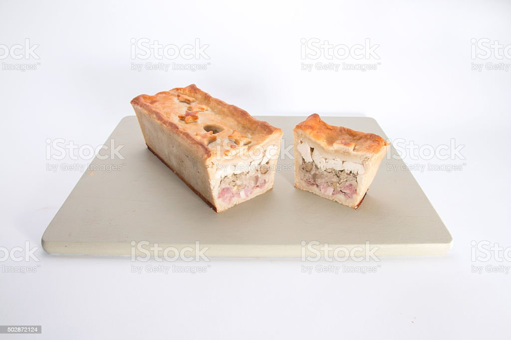 Chicken, Ham and Sausage pie, the  cooked pie showing filling stock photo