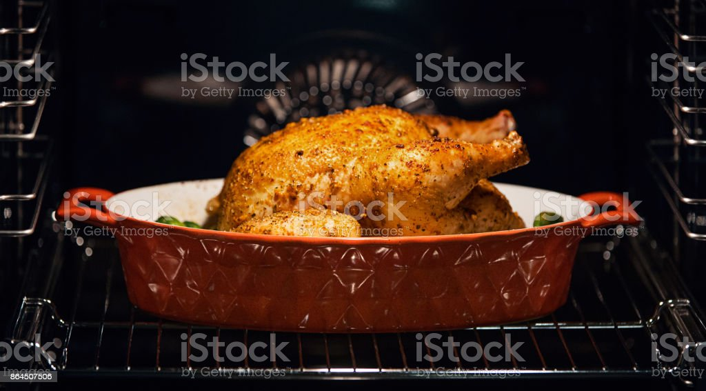 Chicken in an oven. stock photo