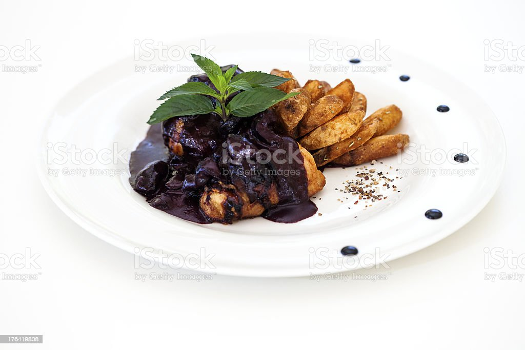 Chicken in chocolate souce with fries royalty-free stock photo