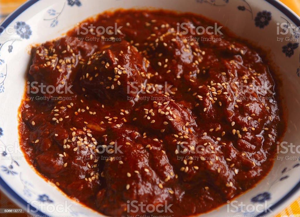 Chicken in Mole Poblano sauce. Puebla, Mexico. stock photo