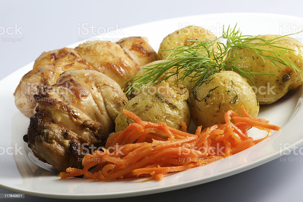 Chicken kebabs and potatoes royalty-free stock photo