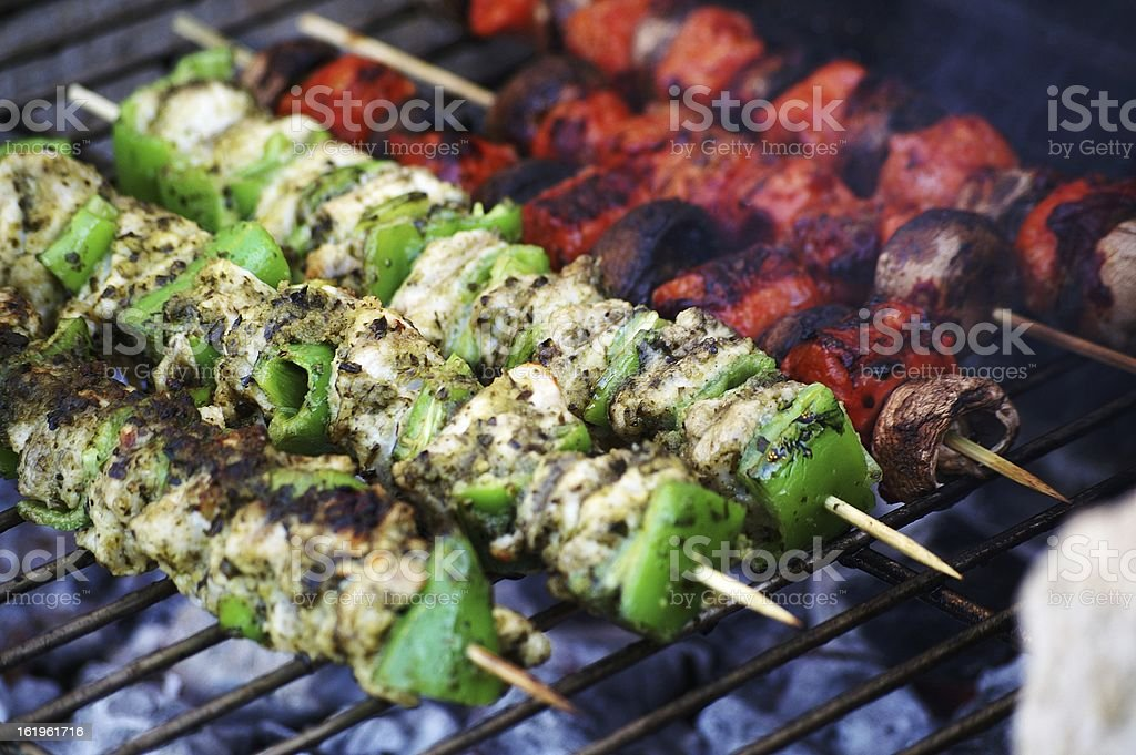 chicken kebabs over charcoal barbecue royalty-free stock photo