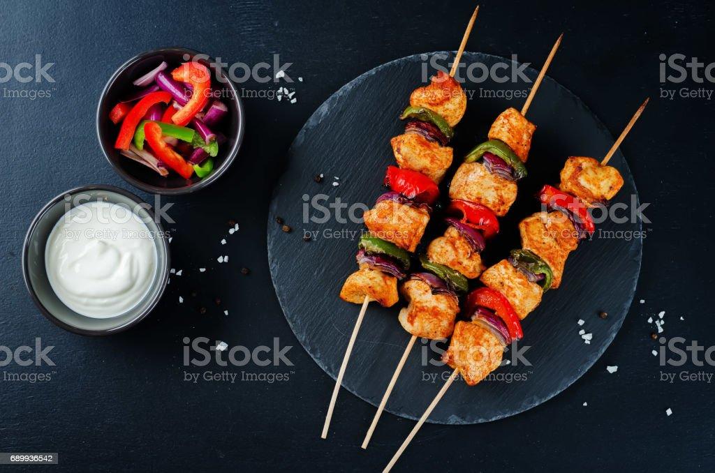 Chicken kebabs with vegetables and greek yogurt sauce stock photo