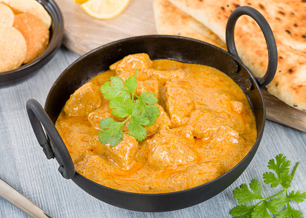 Chicken Korma Chicken Korma - Chicken on a mildly spiced creamy sauce served with naan bread and poppadoms. Indian cuisine. balti dish stock pictures, royalty-free photos & images
