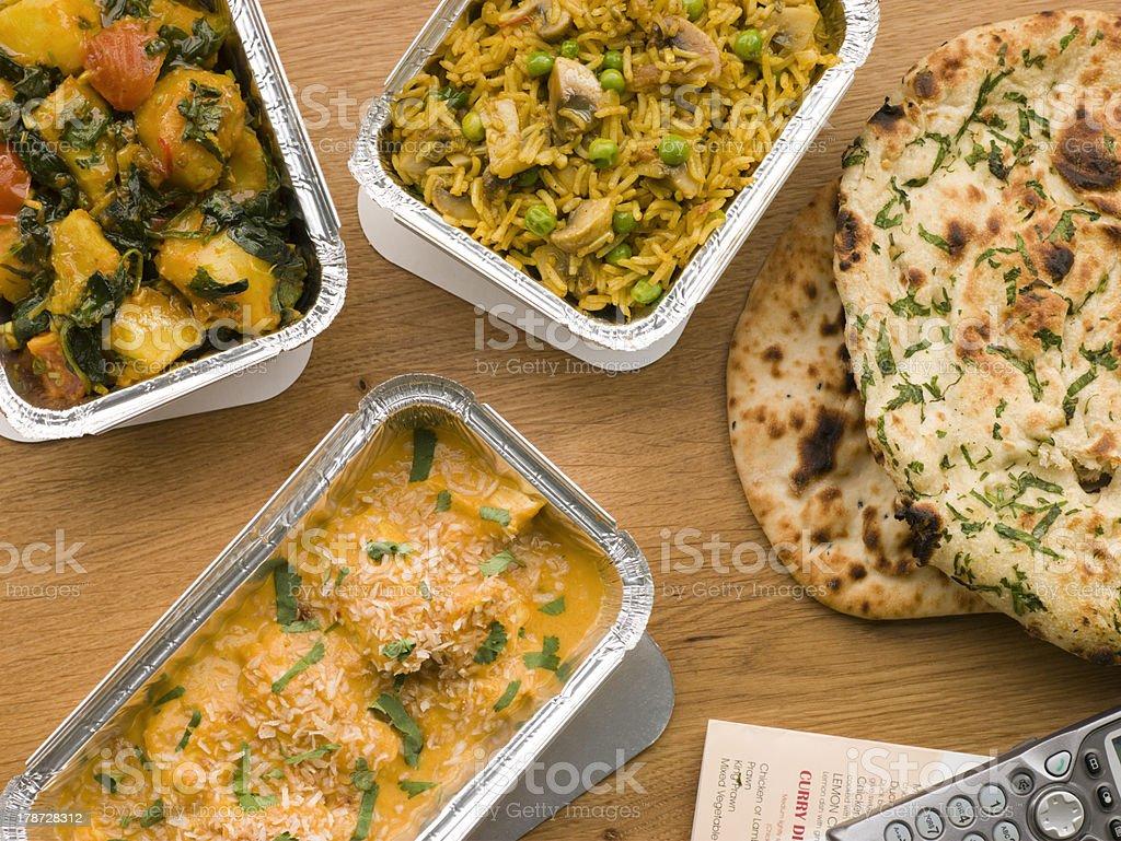 Chicken Korma, Sag Aloo, Mushroom Pilau And Naan Bread stock photo