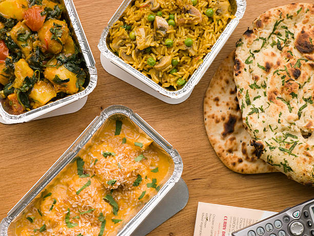 chicken korma, sag aloo, mushroom pilau and naan bread - indian food stock pictures, royalty-free photos & images