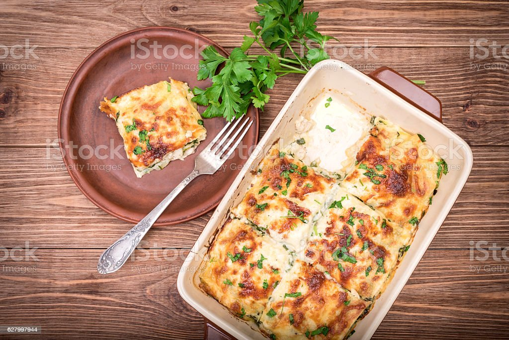 Chicken lasagna and white cheese . stock photo