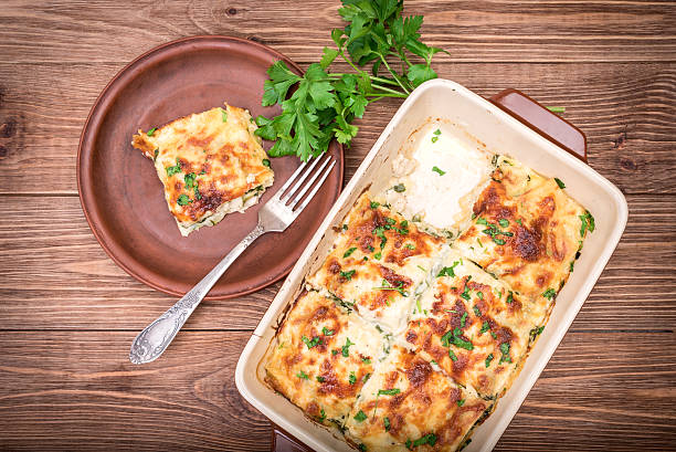chicken lasagna and white cheese . - huhn spinat pasta stock-fotos und bilder
