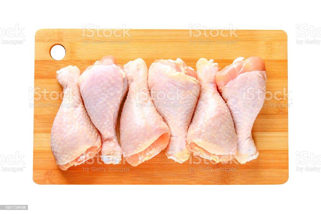 Chicken legs. Chicken legs isolated on white background. Raw chicken legs. Top view. stock photo