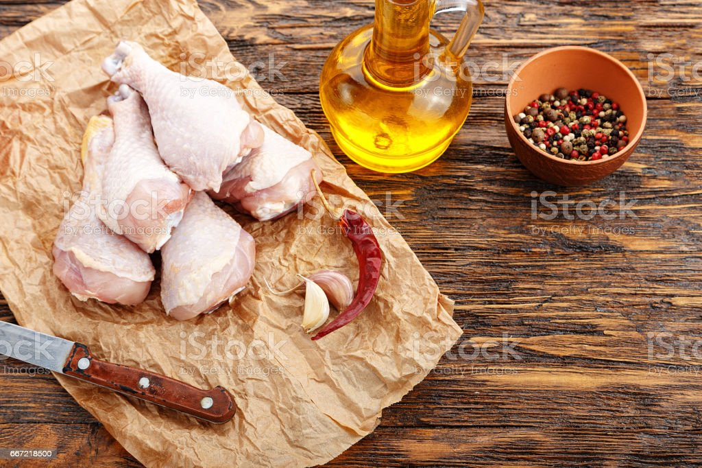 Chicken legs on crumpled paper royalty-free stock photo