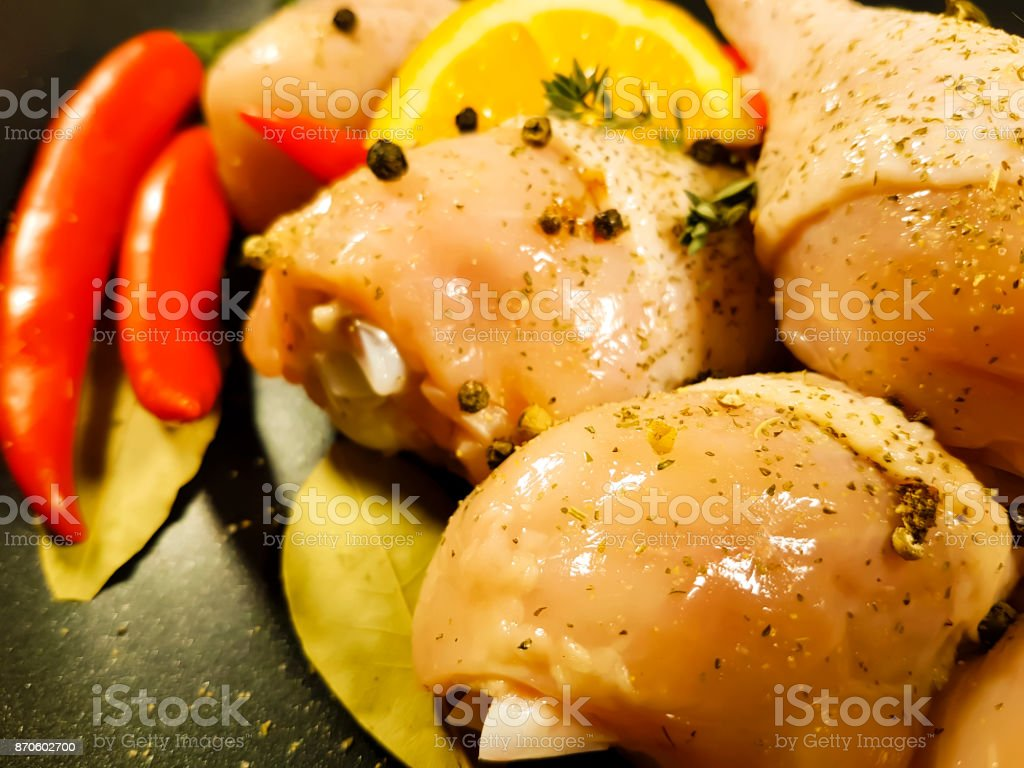 chicken legs raw, frying pan, red chili pepper, stock photo