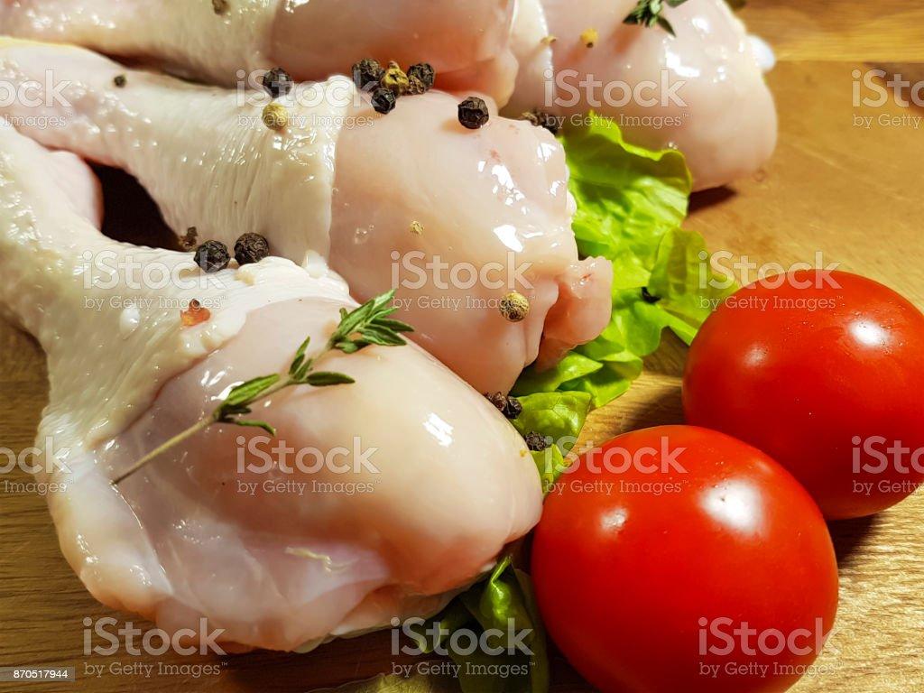 chicken legs raw, preparation, cookin  spice, black pepper, tomato stock photo
