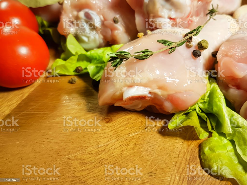 chicken legs raw, preparation, cooking, bay leaf, spice, black pepper, tomato, stock photo