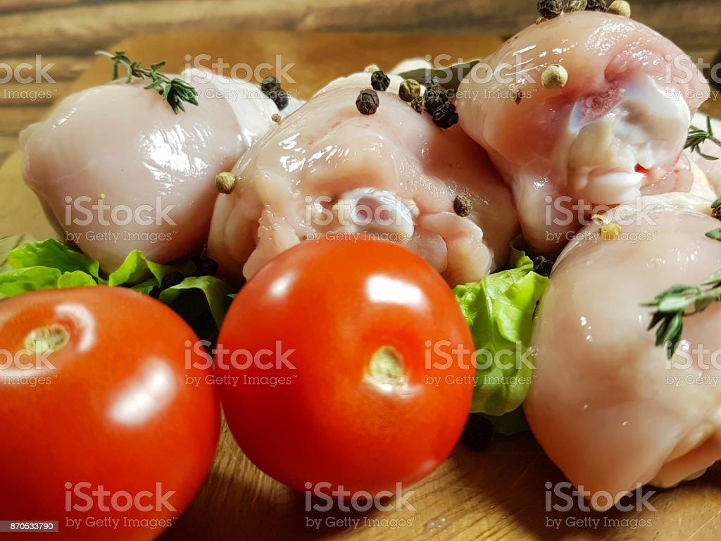 chicken legs raw, preparation, cooking,  spice, black pepper, tomato stock photo