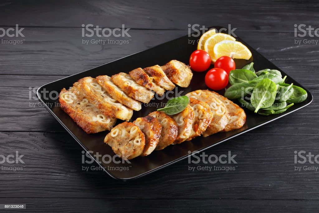 chicken legs stuffed with pasta, close-up stock photo