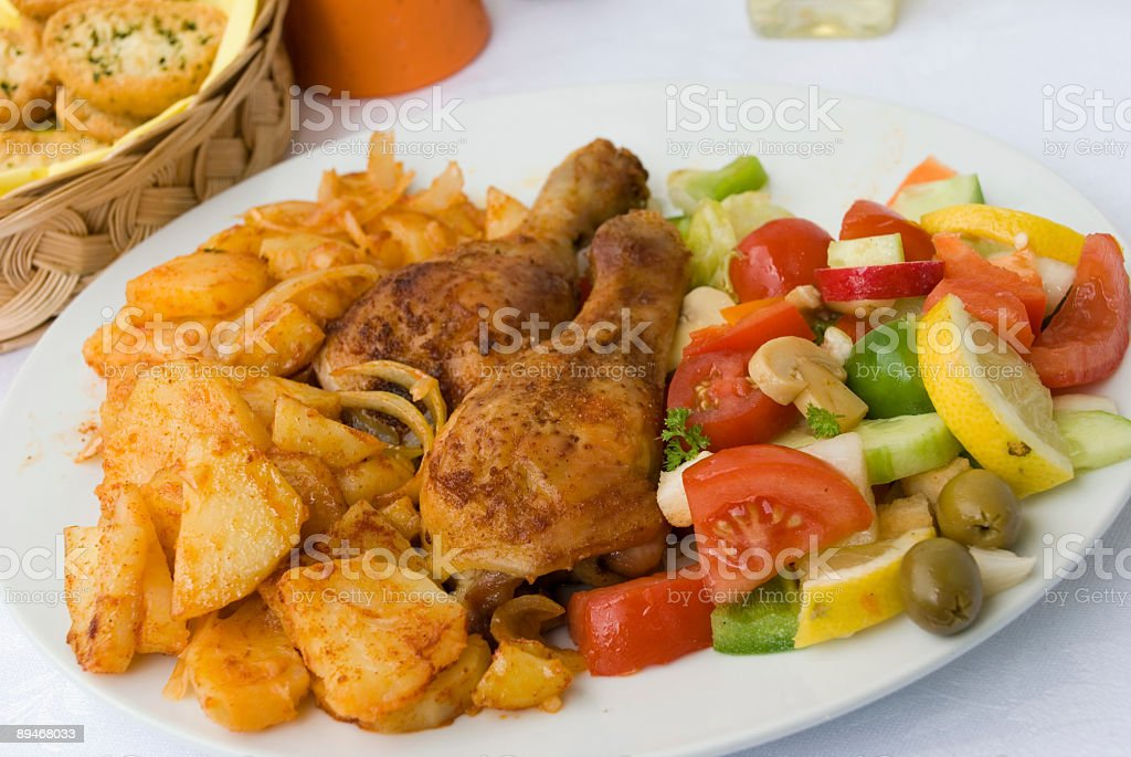 Chicken Legs with Curry-Potatoes and mixed salad royalty-free stock photo