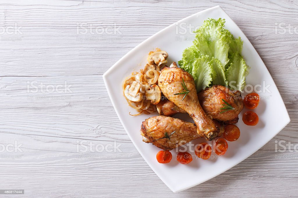 chicken legs with mushrooms and tomatoes horizontal top view stock photo