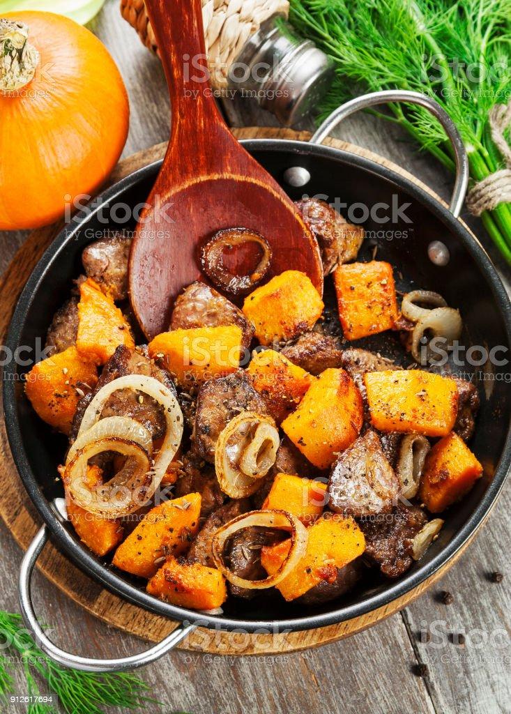 Chicken liver with pumpkin stock photo