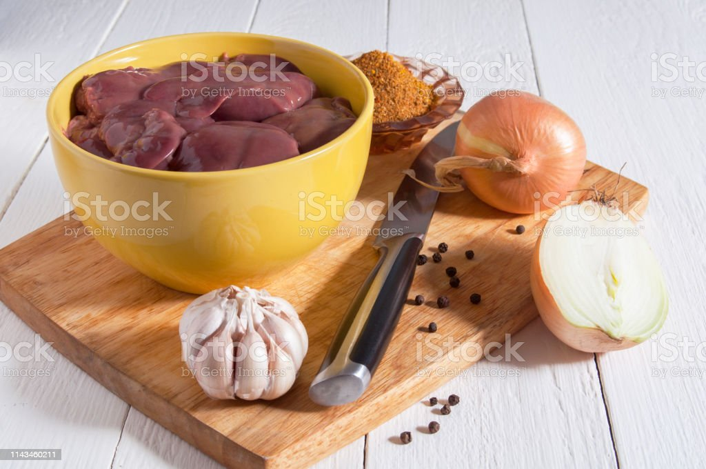 Chicken Livers In A Yellow Bowl On A Cutting Board Near The