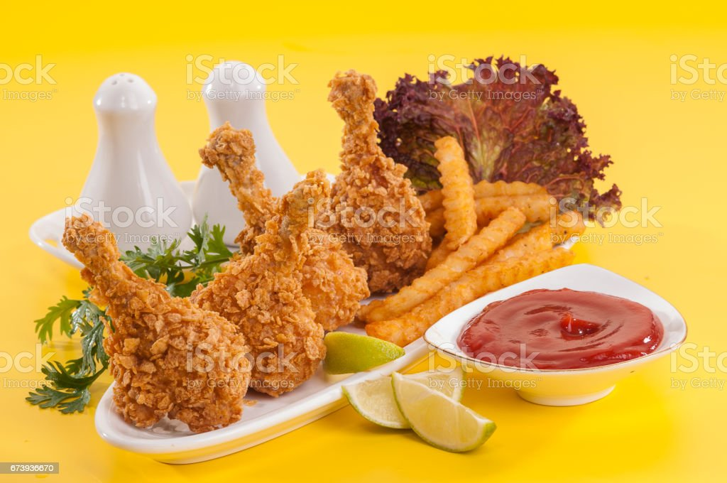 Chicken lollypop on black plate with fries and ketchup foto de stock royalty-free