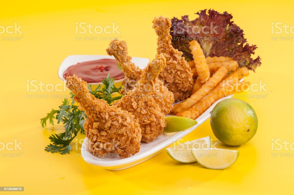 Chicken lollypop on black plate with fries and ketchup photo libre de droits