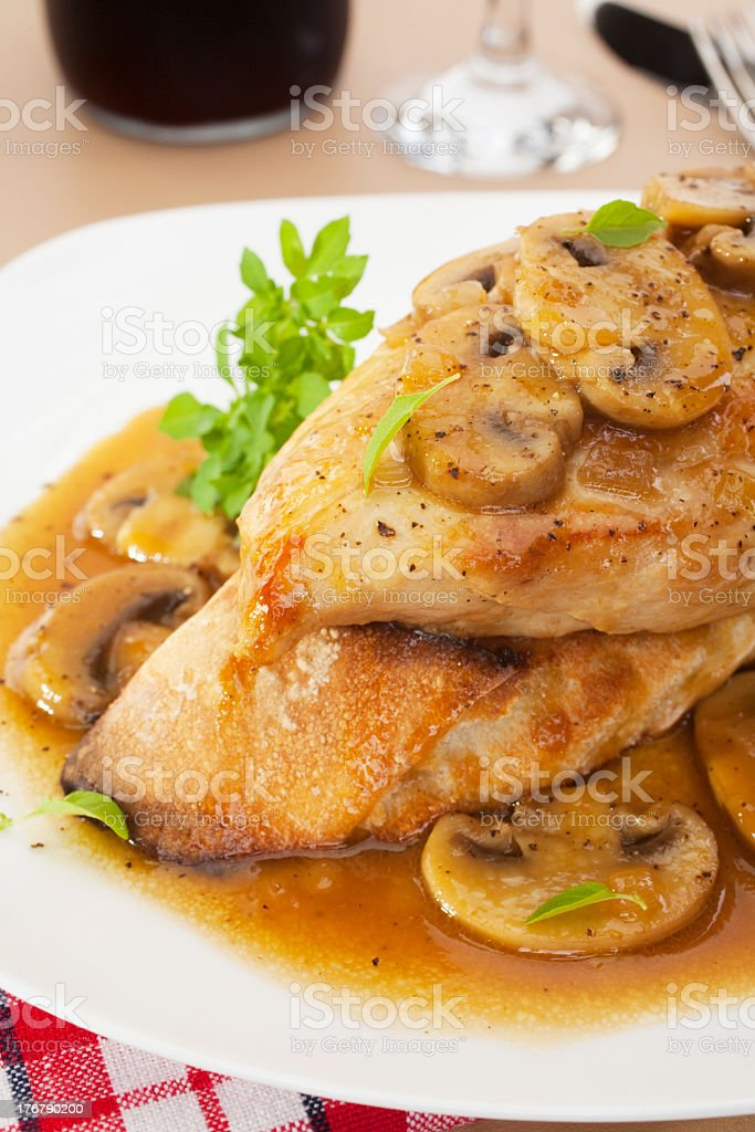Chicken Marsala on a white plate stock photo