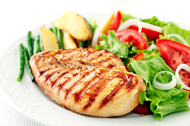 Chicken meal Grilled chicken fillet with salad grilled chicken breast stock pictures, royalty-free photos & images