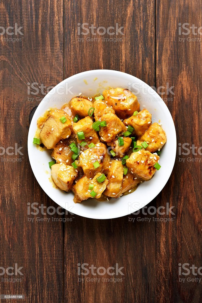 Chicken meat with orange sauce stock photo