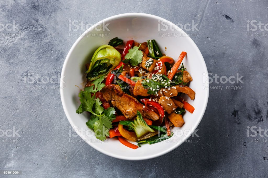Chicken meat with vegetable in bowl stir fry on wok stock photo