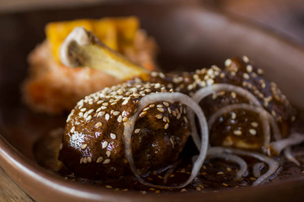 Chicken mole Mexican famous dish Mole Poblano. Chocolate and chilli sauce. puebla state stock pictures, royalty-free photos & images