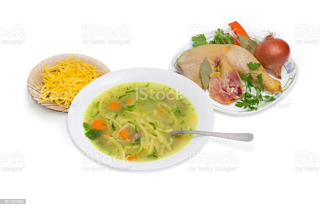 Chicken noodle soup and ingredients for its cooking photo libre de droits