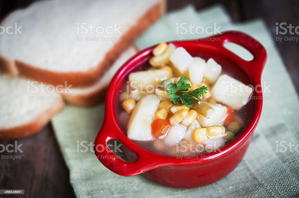 Chicken noodle soup with vegetables in bowl on rustic table royalty-free stock photo