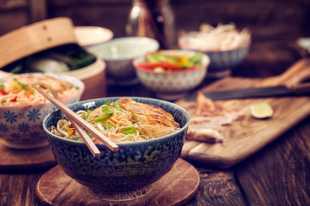chicken noodle stir fry - chinese food stock photos and pictures