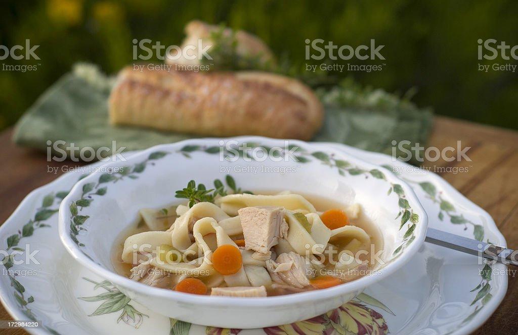 Chicken Noodle & Vegetables Soup Bowl, Leftover Food Dinner royalty-free stock photo