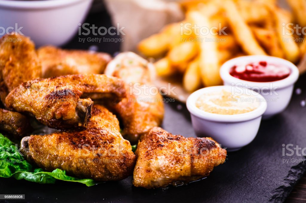 Chicken nuggets and French fries stock photo