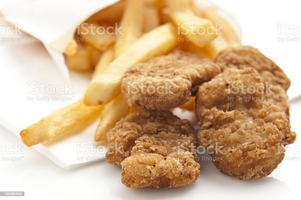 chicken nuggets and fries stock photo