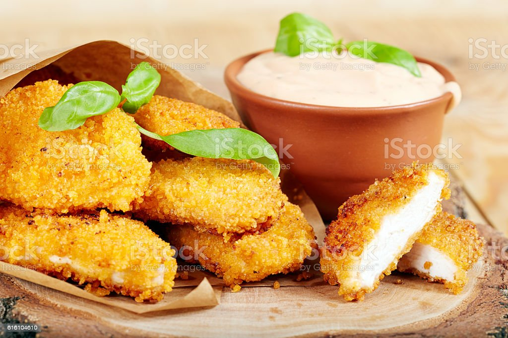 Chicken nuggets and sauce stock photo