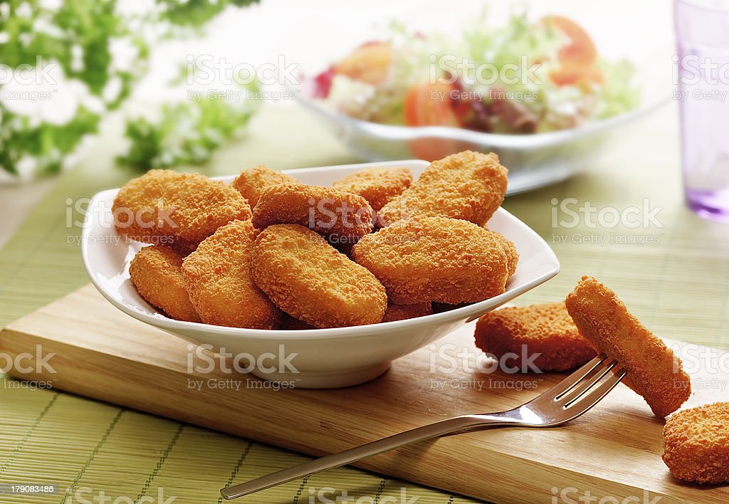 chicken nuggets  in a white bowl stock photo