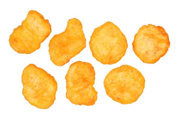 chicken nuggets isolated - fritto foto e immagini stock