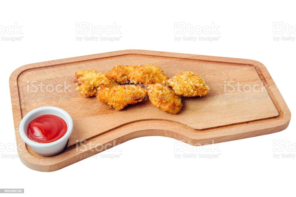 chicken nuggets ketchup on cutting board isolated on white background zbiór zdjęć royalty-free