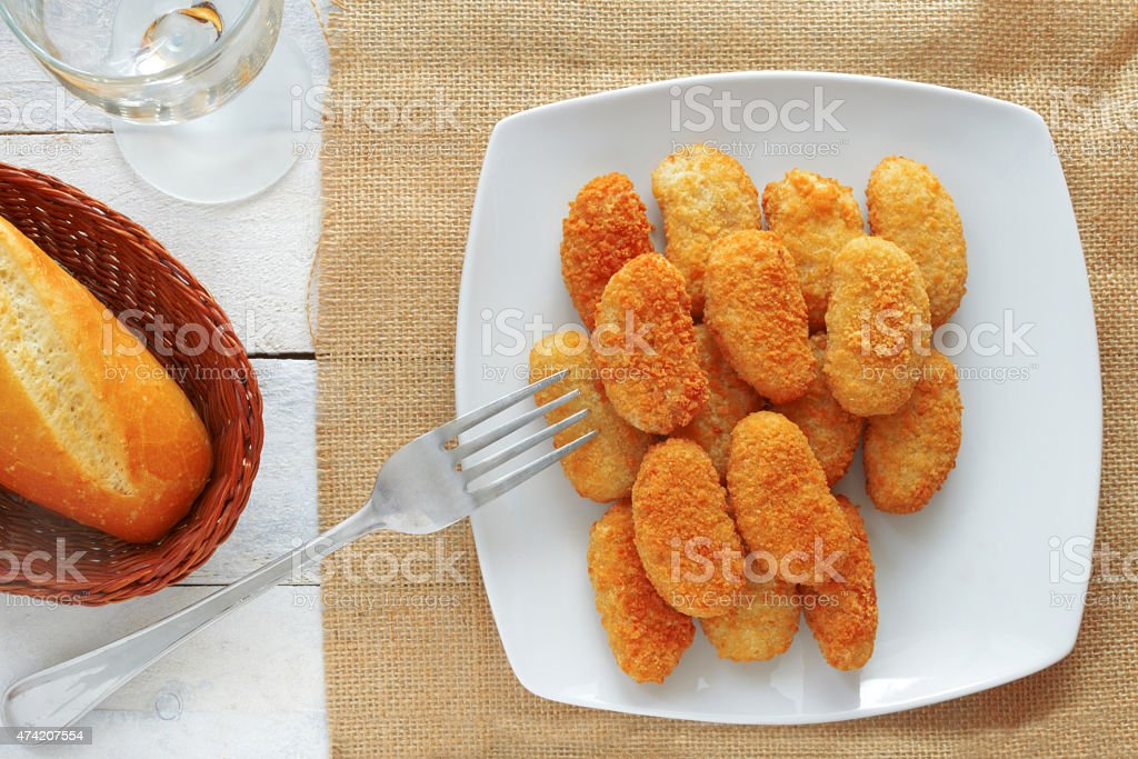 chicken nuggets served in a white bowl, top view stock photo