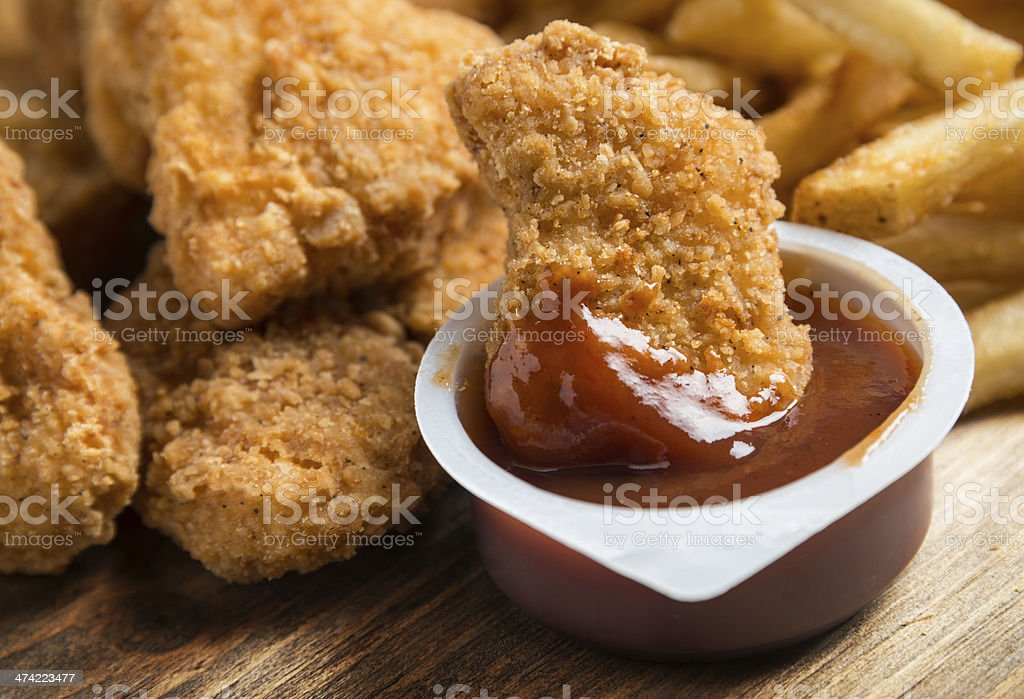 Chicken Nuggets with BBQ sauce stock photo