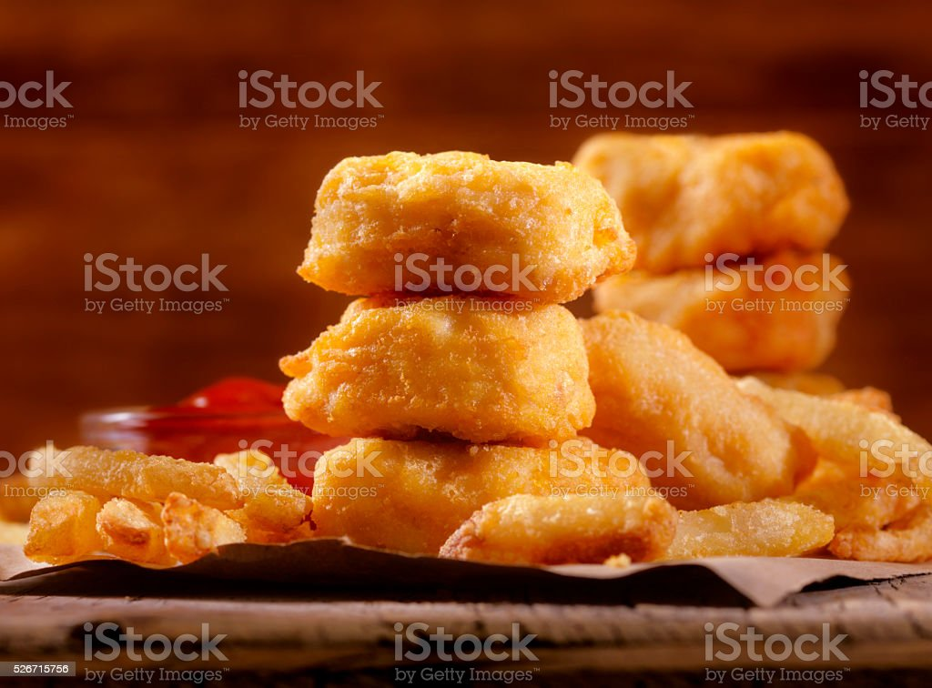 Chicken Nuggets with French Fries and BBQ Sauce Dip stock photo
