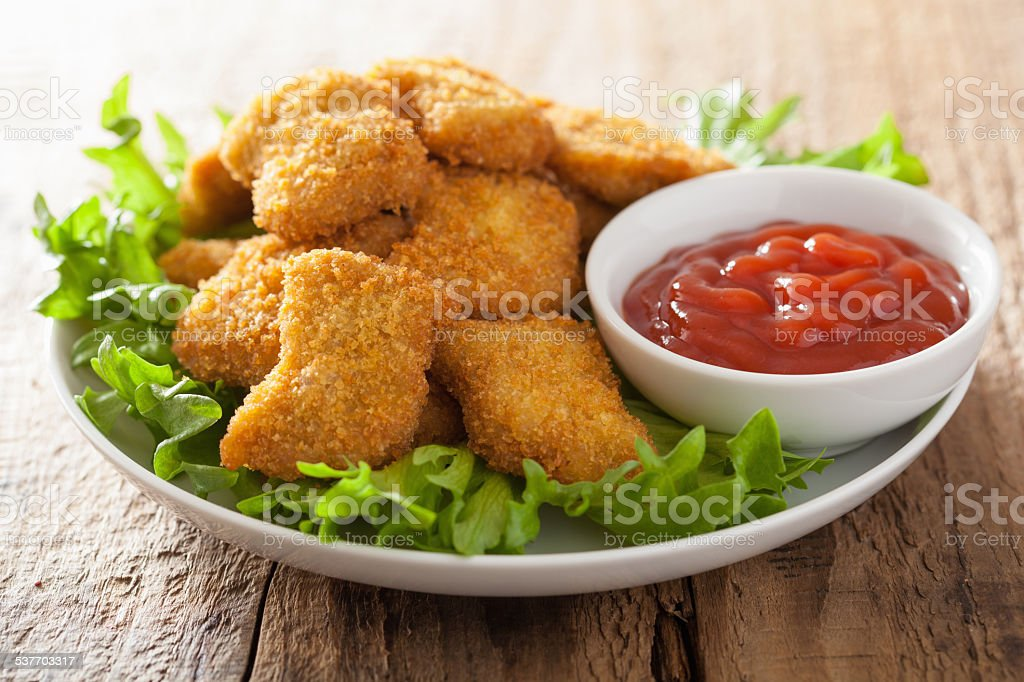chicken nuggets with ketchup stock photo